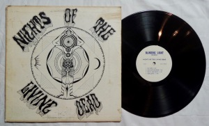 Nights of the Living Dead by Grateful Dead vinyl LP; Blinding Light Records / Big Apple Productions;dead wax: DM2891A71; shiny Lp is VG+; b/w Sleeve is VG- w/ some wear to edges and some spotting; scarce original unofficial release of The Grateful Dead; circa 1971; with rare printed label; A live album, believed to be from an Australian tour, no date or location available.